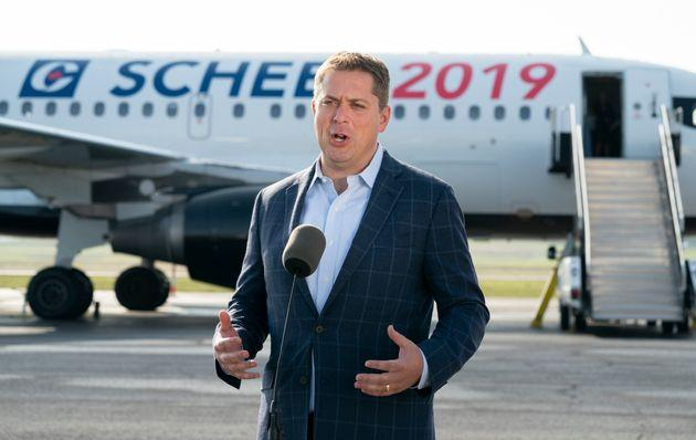 Conservative Leader Andrew Scheer talks with reporters prior to boarding his campaign plane in Ottawa on Sept. 11, 2019.