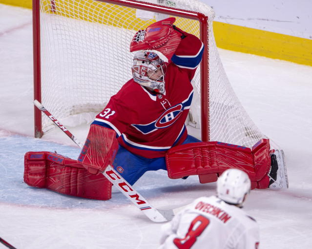 Montreal Canadiens goaltender Carey Price (31) makes a glove save on Washington Capitals left wing Alex Ovechkin (8) during third period NHL hockey action Monday, Nov. 19, 2018 in Montreal. (Ryan Remiorz/The Canadian Press via AP)