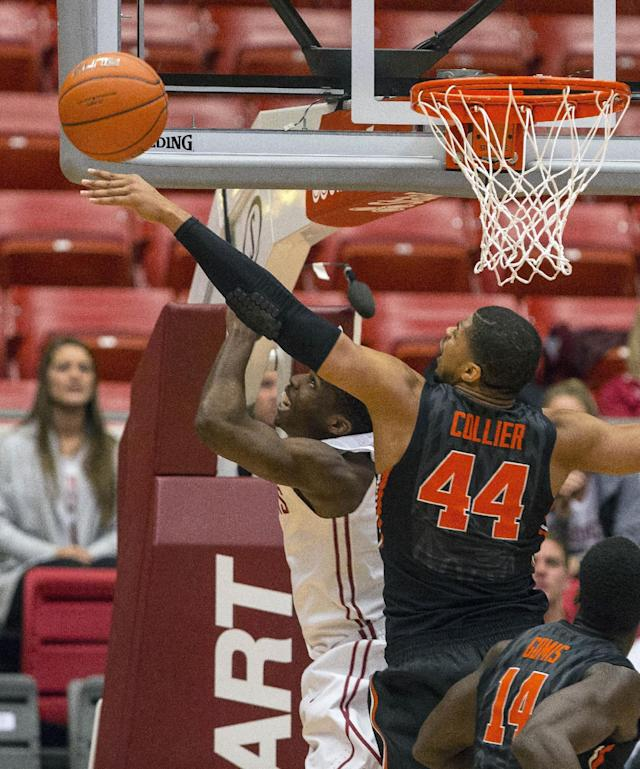 Oregon State forward Devon Collier (44) blocks the layup attempt by Washington State guard Ike Iroegbu, obscured, during the first half of an NCAA college basketball game Wednesday, Jan. 22, 2014, at Beasley Coliseum in Pullman, Wash. (AP Photo/Dean Hare)