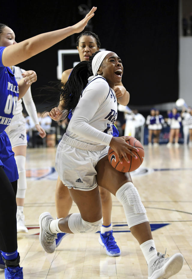 Rice guard Erica Ogwumike (13) drives the lane against Middle Tennessee forward Alex Johnson, left, in the second half of an NCAA college basketball game in the championship game of the Conference USA women's tournament, Saturday, March 16, 2019, in Frisco, Texas. Rice won 69-54. (AP Photo/Jeffrey McWhorter)