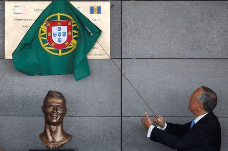 Portugal's President Marcelo Rebelo de Sousa unveils a plaque during the ceremony to rename Funchal airport as Cristiano Ronaldo Airport in Funchal, Portugal March 29, 2017. REUTERS/Rafael Marchante