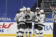 Los Angeles Kings' Adrian Kempe (9) is congratulated by teammates after scoring a goal against the St. Louis Blues during the second period of an NHL hockey game Saturday, Jan. 23, 2021, in St. Louis. (AP Photo/Joe Puetz)