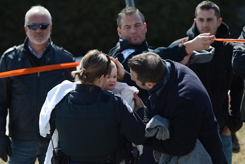 Children are picked up from the care of police at the scene of a shooting in Gatineau, Quebec, Canada on Friday April 5, 2013.  Police evacuated children from a daycare center just outside Canada's capital after an adult was killed by gunfire. Gatineau police Lt. Yves Comtois said all 53 children and the teachers were safe and unharmed. The daycare center sits across the street from a hospital in this Quebec city, just across the river from Ottawa. (AP Photo/The Canadian Press, Sean Kilpatrick)