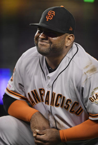 San Francisco Giants third baseman Pablo Sandoval winces after having his hand stepped on while forcing out Los Angeles Dodgers' Max Muncy during the fifth inning of a baseball game, Monday, June 17, 2019, in Los Angeles. (AP Photo/Mark J. Terrill)