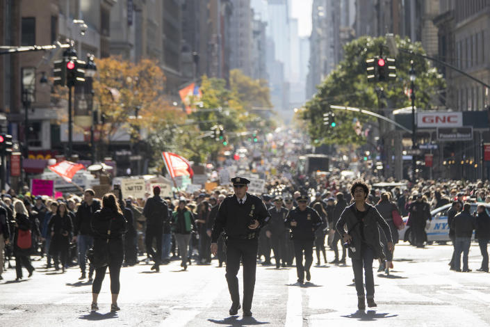 <p>Demonstrators march up Fifth Avenue during a protest against the election of President-elect Donald Trump, Saturday, Nov. 12, 2016, in New York. (AP Photo/Mary Altaffer) </p>