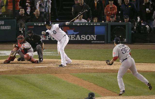 Detroit Tigers' Miguel Cabrera strikes out in the eighth inning against Boston Red Sox relief pitcher Junichi Tazawa during Game 3 of the American League baseball championship series Tuesday, Oct. 15, 2013, in Detroit. (AP Photo/Charlie Riedel)
