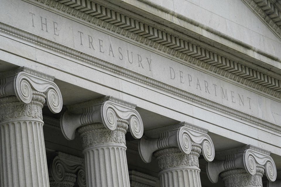 FILE - This May 4, 2021, file photo shows the Treasury Building in Washington. The U.S. budget deficit hit $2.54 trillion for the first 10 months of this budget year, fed by spending to support the country after the pandemic-induced recession. The figures keep the deficit on track to be second largest annual shortfall in U.S. history, behind only the most recent fiscal year that ended Sept. 30. (AP Photo/Patrick Semansky, File)