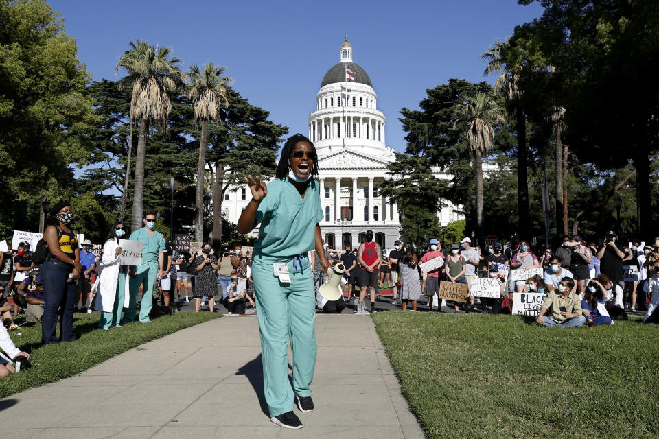 Dr. Zola Chihombori Quao speaks at a rally near the California Capitol in Sacramento, Calif., of medical care professionals,, denouncing the death of George Floyd, who died after being restrained by Minneapolis police on May 25. (AP Photo/Rich Pedroncelli)