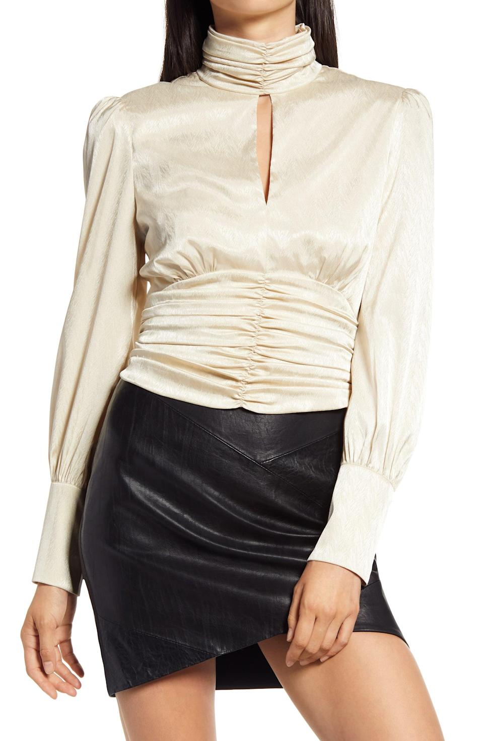 <p><span>WAYF Holly Mock Neck Satin Jacquard Top</span> ($31, originally $78)</p>