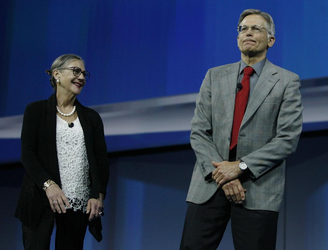 Alice Walton, left, and Arvest Bank Chairman Jim Walton, right, speak to a crowd of shareholders from around the world during the Wal-Mart shareholders meeting in Fayetteville, Ark., Friday, June 7, 2013. (AP Photo/Gareth Patterson)