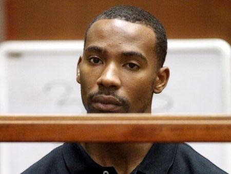 Former Los Angeles Lakers guard Javaris Crittenton (R) appears in Los Angeles Superior Court for an extradition hearing with attorney Brian Steel (L) in downtown Los Angeles August 31, 2011. REUTERS/Al Seib/Pool