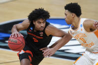 Oregon State guard Ethan Thompson (5) drives on Tennessee guard Jaden Springer (11) during the second half of a men's college basketball game in the first round of the NCAA tournament at Bankers Life Fieldhouse in Indianapolis, Friday, March 19, 2021. (AP Photo/Paul Sancya)