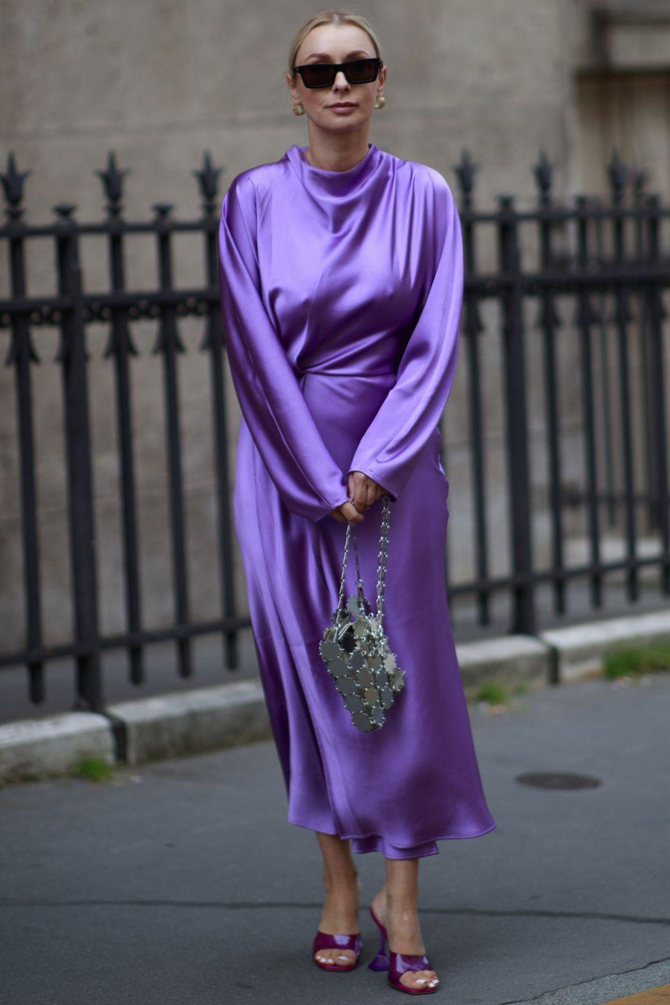 <p>Dressing head-to-toe in one shade is a surefire way to make your outfit look more expensive – we love this silky purple number matched with Amina Muaddi heels. </p>