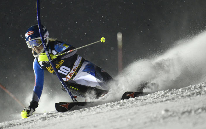 Mikaela Shiffrin, of the United States, speeds past a pole on her way to clock the second fastest time during the first run of an alpine ski, women's World Cup slalom, in Are, Sweden, Thursday, Dec. 20, 2012. (AP Photo/Giovanni Auletta)