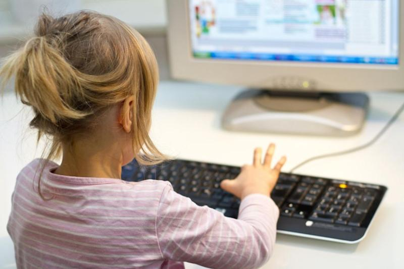 The little girl was logging on ad buying gems for her online game. Photo: Getty Images