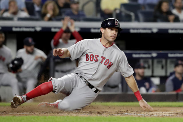 Boston Red Sox's Ian Kinsler scores on a sacrifice fly by Oscar Hernandez off New York Yankees starting pitcher J.A. Happ during the third inning of a baseball game Tuesday, Sept. 18, 2018, in New York. (AP Photo/Julio Cortez)