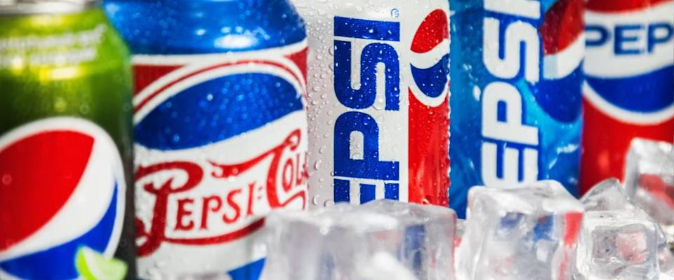 Carbonated Pepsi drink in different packaging design times.