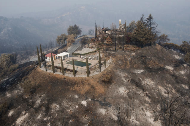 <p>A swimming pool is all that remains of a hilltop home after being burned by a wildfire that swept through Shasta County an area west of Redding, Calif., Friday, Aug. 10, 2018. (Photo: Michael Burke/AP) </p>
