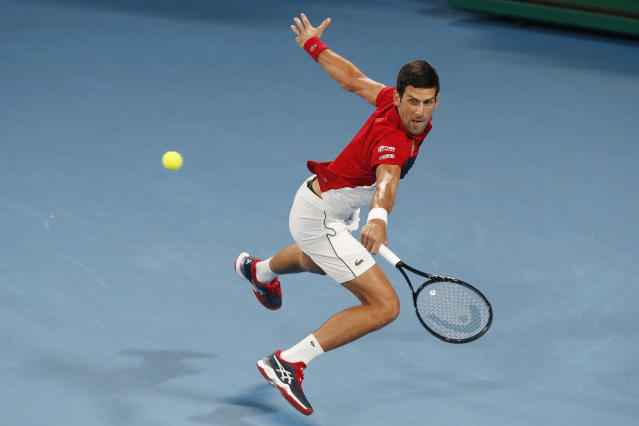 Novak Djovovic of Serbia plays a shot against Rafael Nadal of Spain during their ATP Cup tennis match in Sydney, Sunday, Jan. 12, 2020. (AP Photo/Steve Christo)