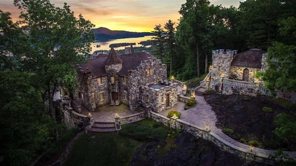 The glowing back side of the castle with various private entryways. - Credit: Courtesy of Airbnb
