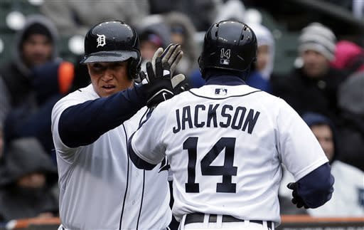 Detroit Tigers' Austin Jackson is congratulated by Miguel Cabrera after scoring on Torii Hunter's RBI single in the second inning of a baseball game against the Toronto Blue Jays in Detroit, Thursday April 11, 2013. (AP Photo/Paul Sancya)