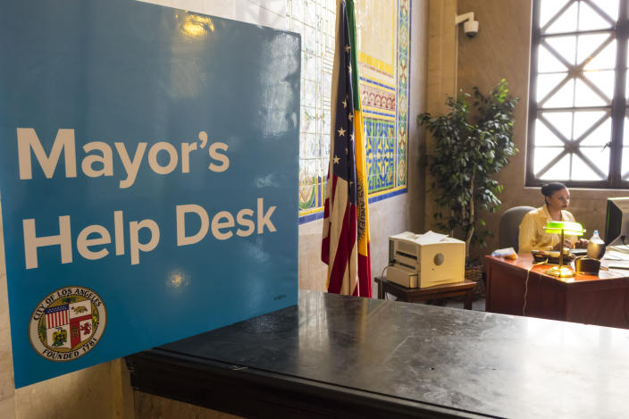 Mayor's Help Desk sign. (Photo by: Jeffrey Greenberg/Universal Images Group via Getty Images)