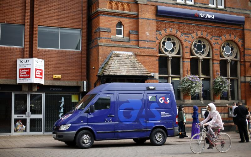A G4S security van is parked outside a bank in Loughborough
