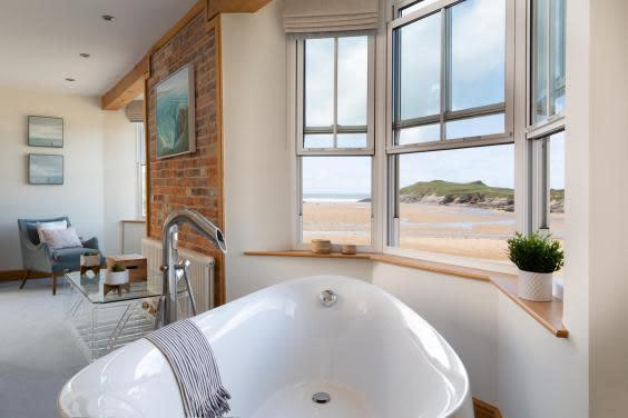 Relax in the tub and watch the tide roll in (Cornish Gems)