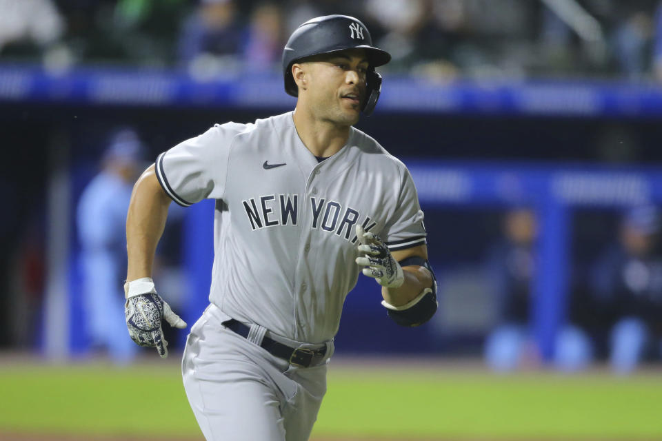 New York Yankees' Giancarlo Stanton runs after hitting a two-run home run off Toronto Blue Jays pitcher Anthony Castro during the seventh inning of a baseball game, Thursday, June 17, 2021, in Buffalo, N.Y. (AP Photo/Jeffrey T. Barnes)