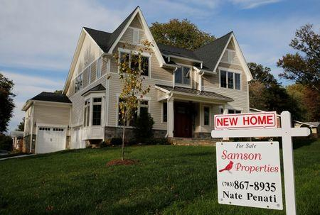 A real estate sign advertising a new home for sale is pictured in Vienna, Virginia
