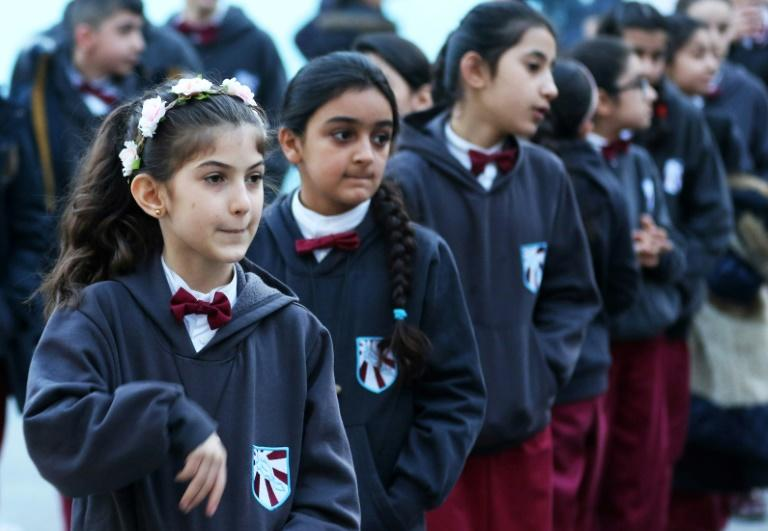 Iraqi Christian students line up at the Latin patriarchate school in the Marka district of the Jordanian capital Amman