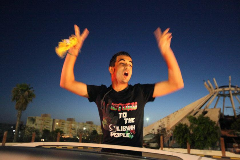 A man celebrates at the end of voting day in Sirte July 7, 2012. Libyans defied violence and boycott calls to rush to the polls in their first free national election in 60 years on Saturday, parting with the legacy of Muammar Gaddafi's dictatorship. REUTERS/Anis Mili