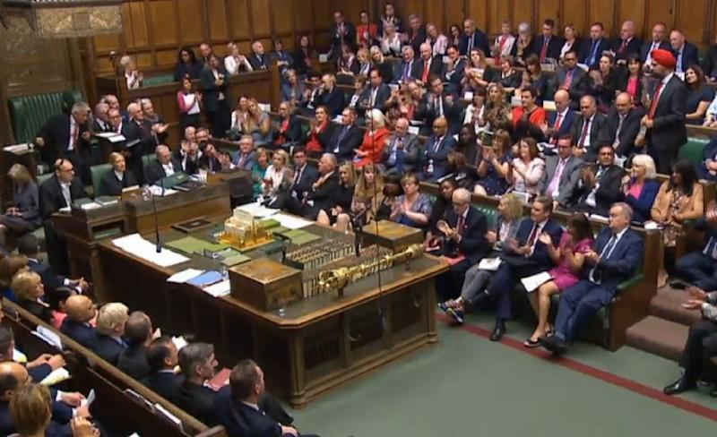 Labour MPs clapping the remarks of Tanmanjeet Singh Dhesi, Labour MP, for Slough) as he calls on Prime Minister Boris Johnson to apologise for his derogatory comments after he likened Muslim women who wear a veil to bank robbers and letter boxes, during Prime Minister's Questions in the House of Commons, London.