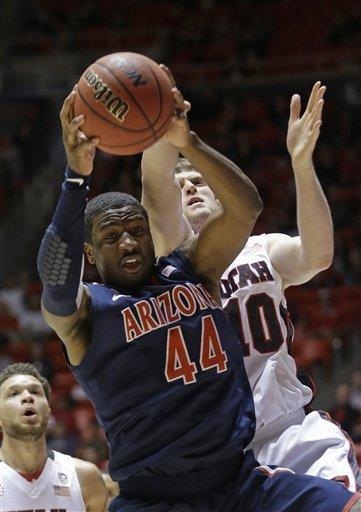 Arizona's Solomon Hill (44) pulls down a rebound in front of Utah's Renan Lenz (10) in the first half during an NCAA college basketball game on Sunday, Feb. 17, 2013, in Salt Lake City. (AP Photo/Rick Bowmer)
