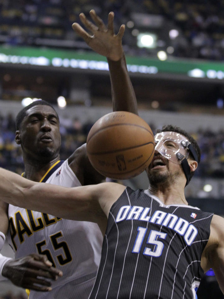 Indiana Pacers center Roy Hibbert, left, blocks the shot ove Orlando Magic forward Hedo Turkoglu in the first half of an NBA first-round playoff basketball game in Indianapolis, Saturday, April 28, 2012. (AP Photo/Michael Conroy)