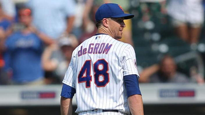Jul 7, 2021; New York City, New York, USA; New York Mets starting pitcher Jacob deGrom (48) walks off the field after pitching the top of the seventh inning against the Milwaukee Brewers at Citi Field.