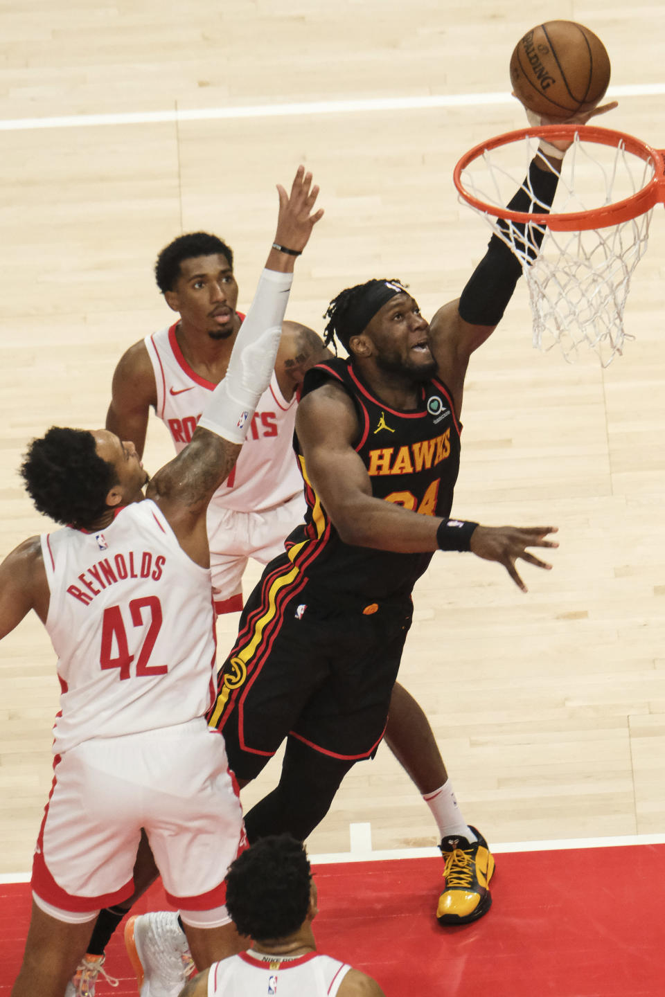 Atlanta Hawks forward Bruno Fernando (24) goes up for the slam against the Houston Rockets during the second half of an NBA basketball game on Sunday, May 16, 2021, in Atlanta. (AP Photo/Ben Gray)