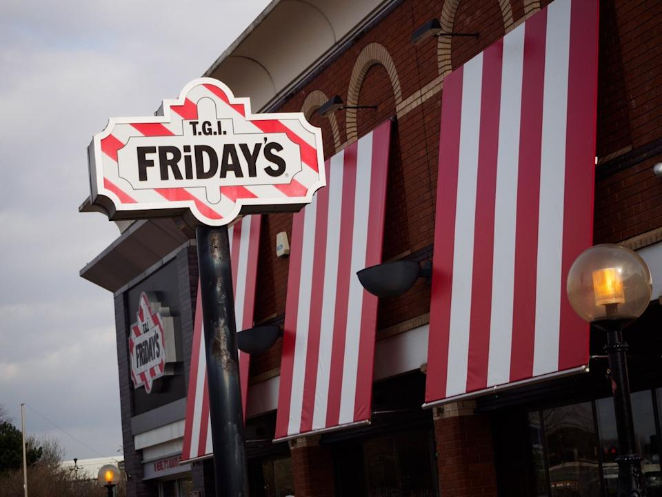 The exterior and logo of a T.G.I. Friday's restaurant