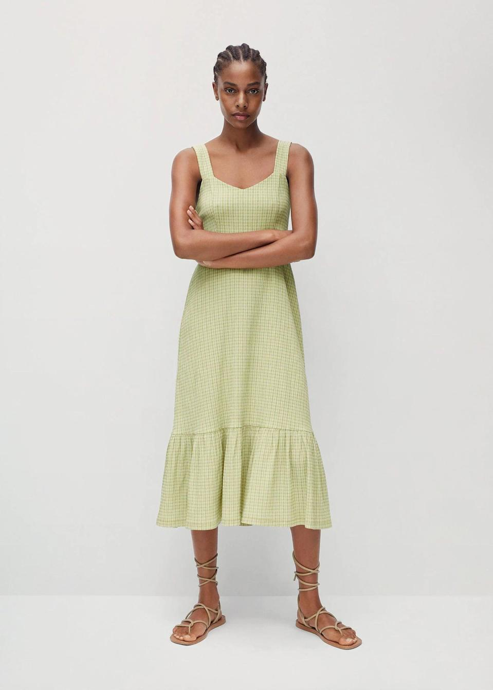 <p>The silhouette and tiered hem of this <span>Mango Gingham Check Dress</span> ($50) lend it a chic look.</p>