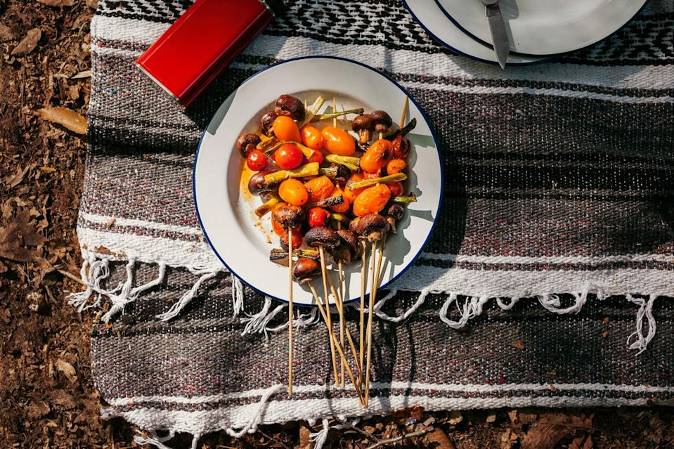 """These skewers are just the thing for the next time you go camping. Any small, fresh mushrooms will do. <a href=""""https://www.epicurious.com/recipes/food/views/marinated-mushroom-tomato-and-scallion-skewers-56389758?mbid=synd_yahoo_rss"""" rel=""""nofollow noopener"""" target=""""_blank"""" data-ylk=""""slk:See recipe."""" class=""""link rapid-noclick-resp"""">See recipe.</a>"""