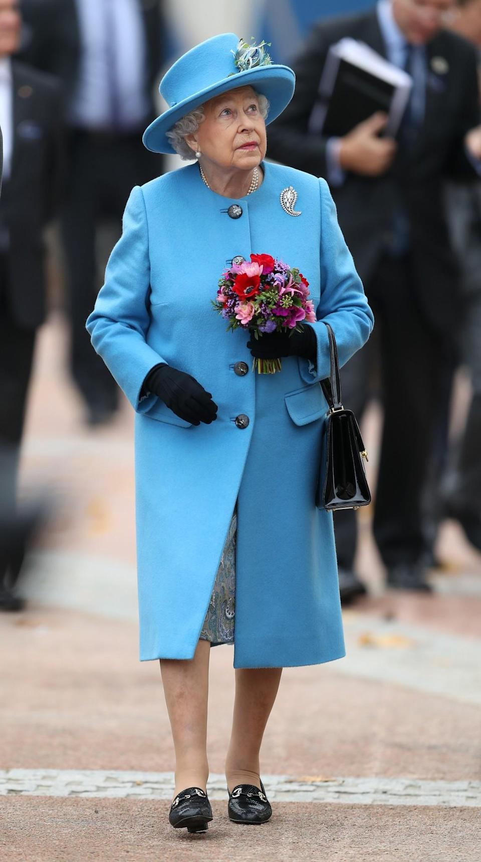 <p>The Queen donned a matching bright blue coat and hat for a visit to Dorchester.<br><i>[Photo: PA]</i> </p>