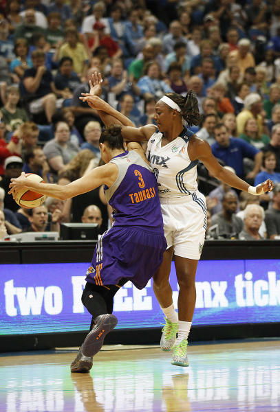 Minnesota Lynx guard Monica Wright, right, fouls Phoenix Mercury guard Diana Taurasi, left, in the first half of a WNBA basketball game, Sunday, July 7, 2013, in Minneapolis. (AP Photo/Stacy Bengs)