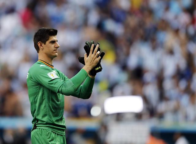 CORRECTS PHOTOGRAPHER'S BYLINE - Belgium goalkeeper Thibaut Courtois greets fans at the end of the World Cup quarterfinal soccer match between Argentina and Belgium at the Estadio Nacional in Brasilia, Brazil, Saturday, July 5, 2014. Argentina won 1-0
