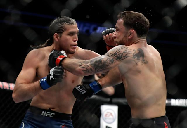 Frankie Edgar (R) and Brian Ortega fight during their featherweight bout during UFC 222 at T-Mobile Arena on March 3, 2018, in Las Vegas. Ortega won by TKO. (Getty Images)