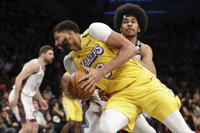 Los Angeles Lakers' Anthony Davis (3) spins past Brooklyn Nets' Jarrett Allen during the first half of an NBA basketball game Thursday, Jan. 23, 2020, in New York. (AP Photo/Frank Franklin II)