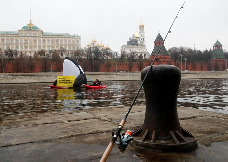 Greenpeace activists take part in a protest in front of the Kremlin against animal rights violations, in Moscow