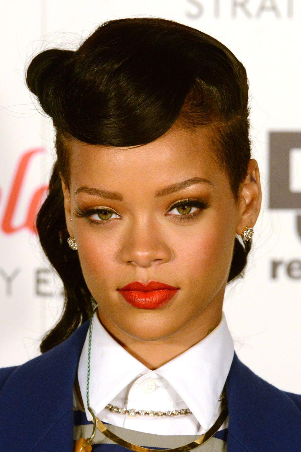 <p>Retro styles like this 1940s wave prove timeless on the singer. Rihanna wears her hair wavy and swept up to frame her face. </p>