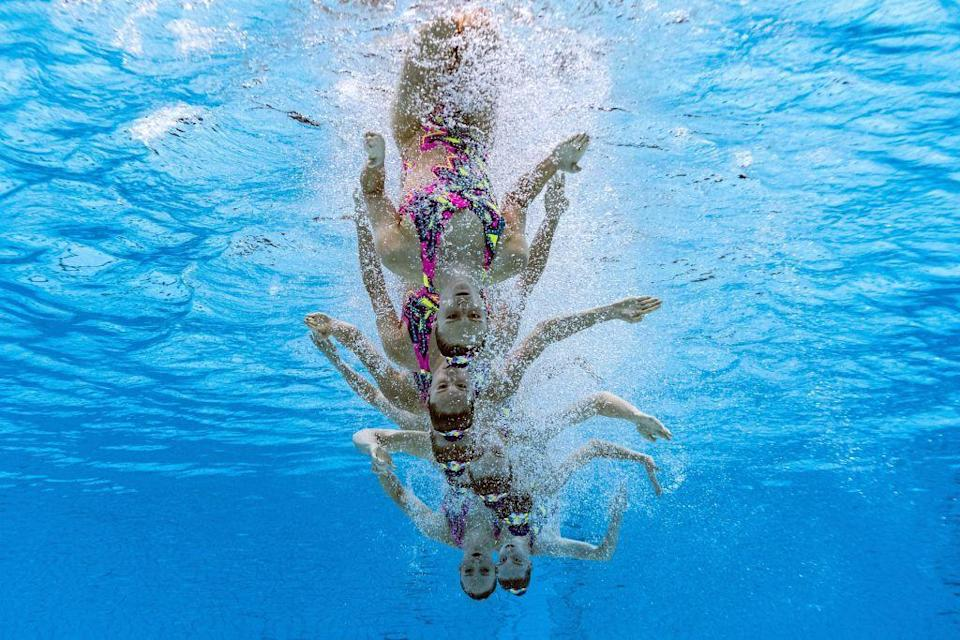 <p>An underwater view shows Team Canada as they compete in the team technical routine artistic swimming event.</p>