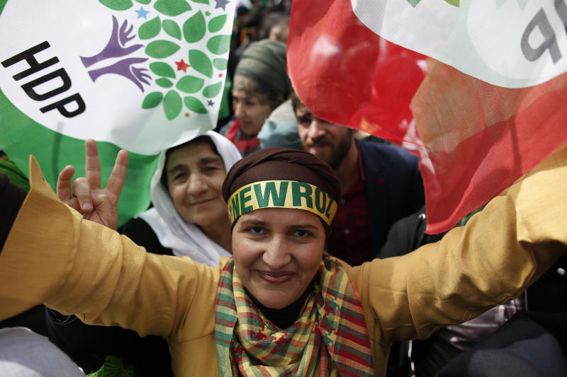 Supporters of pro-Kurdish Peoples' Democratic Party, or HDP, gather to celebrate the Kurdish New Year and to attend a campaign rally for local elections that will test the Turkish president's popularity, in Istanbul, Sunday, March 24, 2019. The HDP held the event amid the municipal office races that have become polarizing and a government crackdown on its members for alleged links to outlawed Kurdish militants. (AP Photo/Emrah Gurel)