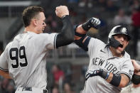 New York Yankees second baseman Rougned Odor (12) celebrates with Aaron Judge (99) after hitting a solo home run in the seventh inning of a baseball game against the Atlanta Braves Tuesday, Aug. 24, 2021, in Atlanta. (AP Photo/John Bazemore)